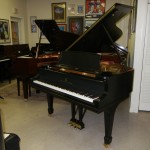 restored steinway and sons grand piano on display