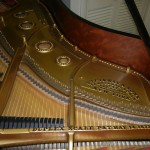 close up of piano strings after restoration