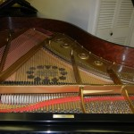 used piano restored with new piano strings