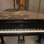 piano with damage on top