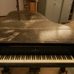 closeup of surface damage on grand piano rebuild