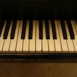 closeup of yellowed piano keys