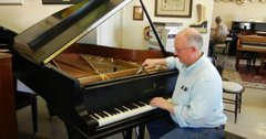 john zeiner working on piano tuning